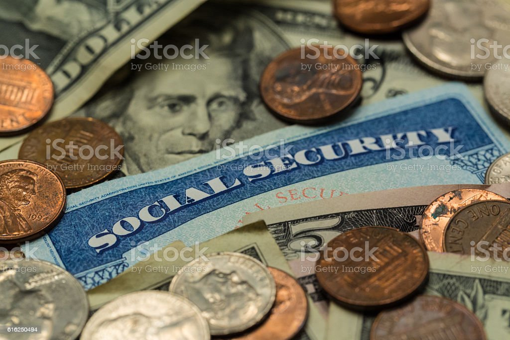 Close Up of Social Security Card with Cash stock photo