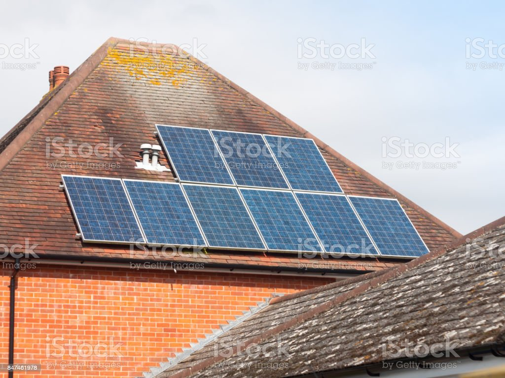 close up of solar panels on roof home stock photo
