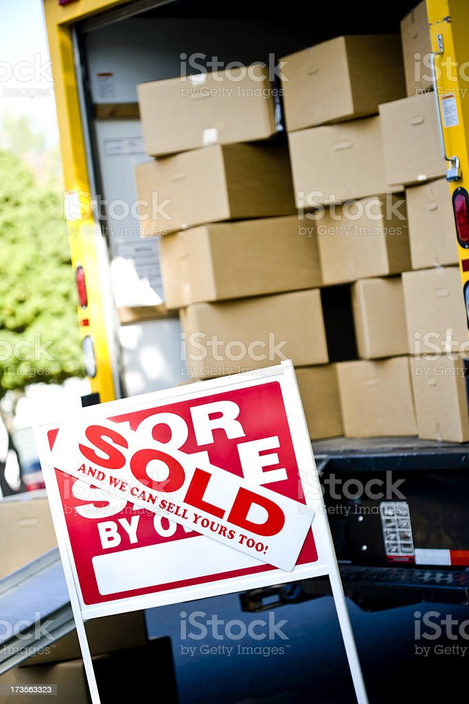 close up of sold sign and moving truck royalty-free stock photo