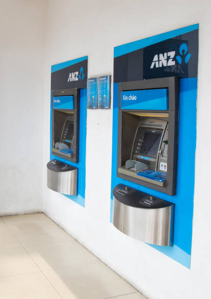 Close up of some automatic teller machine (ATM) of ANZ commercial bank in Hanoi capital stock photo