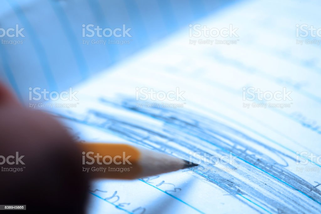 Close Up Of Someone Scribbling Out Something Previously Written stock photo