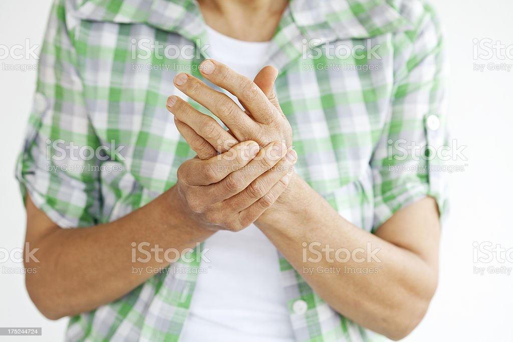 Close up of someone with arthritis rubbing hands stock photo