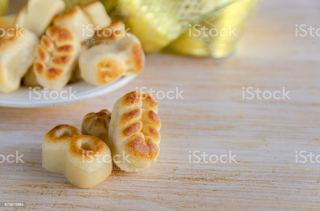 Close up of Spanish Christmas marzipan sweets, Figuritas de mazapan with christmas decoration on wooden table. Traditional treat consumed during winter holidays in Spain. stock photo