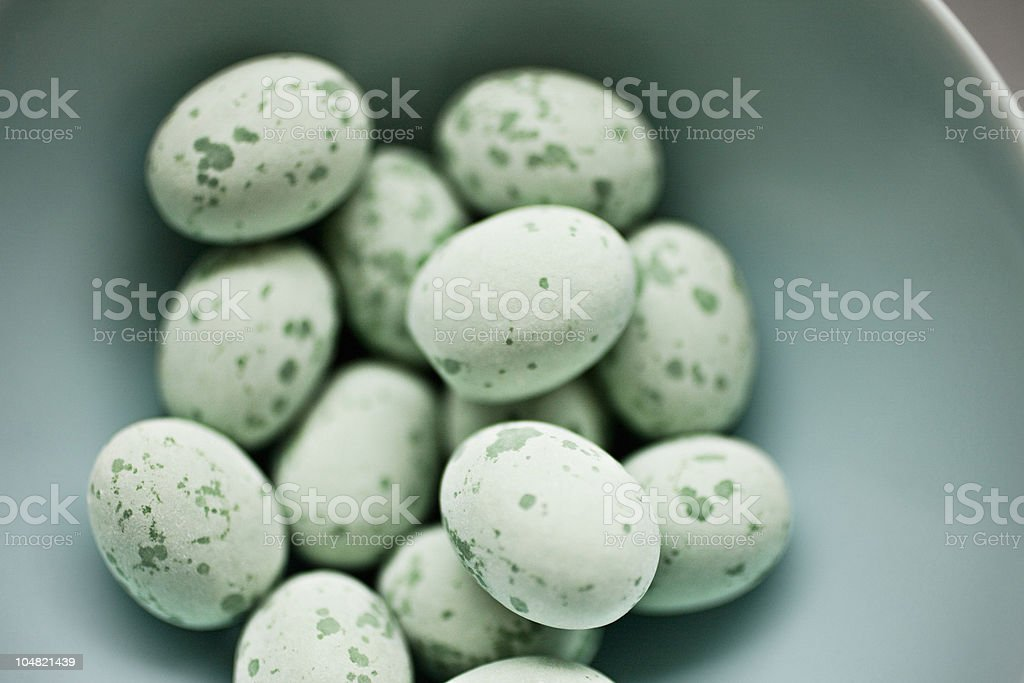 Close up of speckled blue candy eggs in bowl royalty-free stock photo