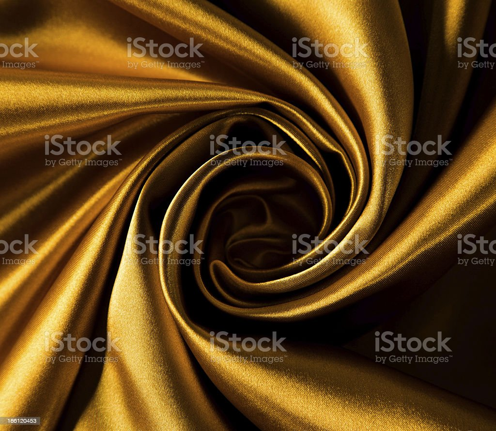 Close up of spiral of gold satin royalty-free stock photo