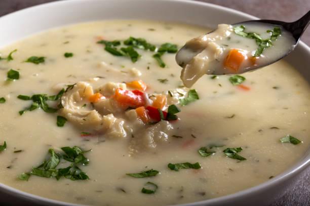 Close up of spoon with Romanian traditional soup - Ciorba de Burta stock photo