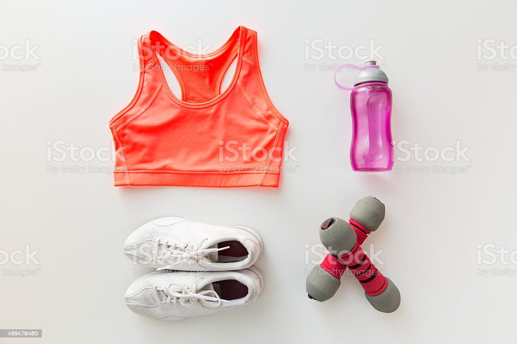 close up of sportswear, dumbbells and bottle stock photo