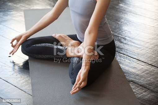 istock Close up of sporty young woman in Lotus pose 846053654