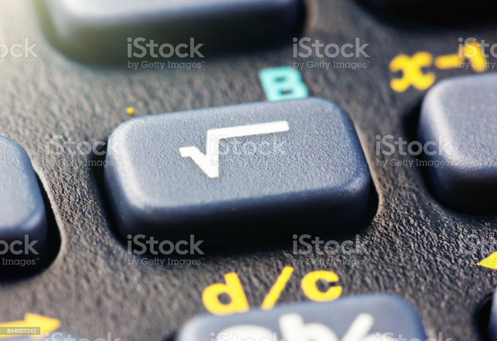 Close up of square root key on scientific calculator stock photo