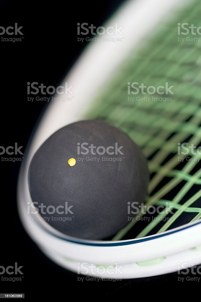 close up of squash ball on racquet royalty-free stock photo