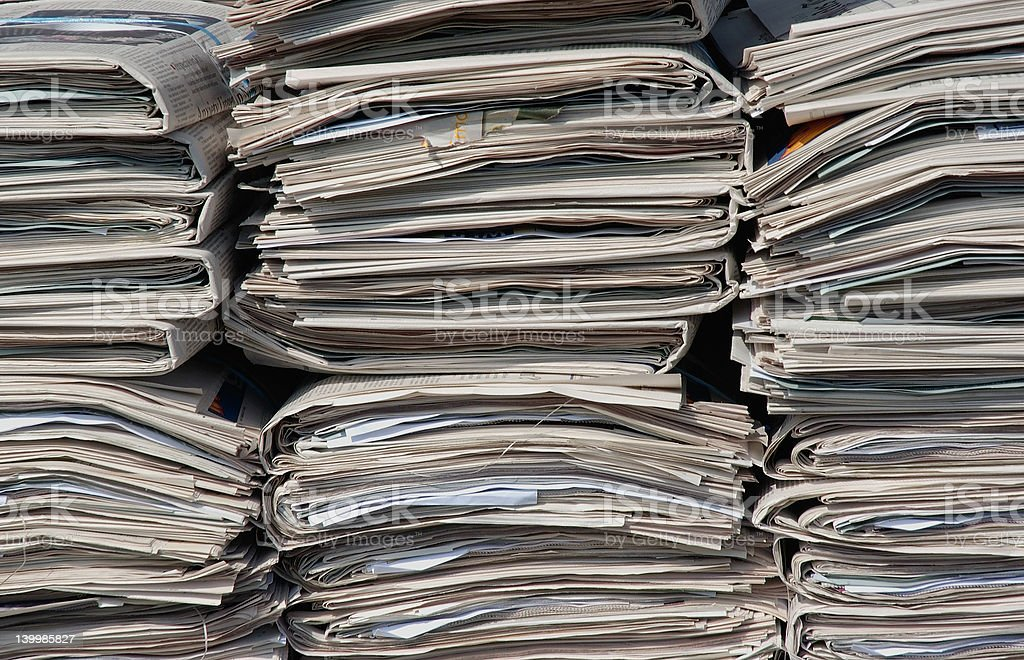 Close up of stacks of newspapers royalty-free stock photo