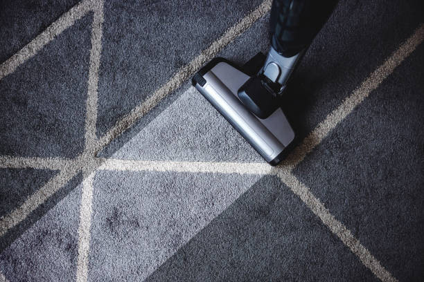 Close up of steam cleaner cleaning very dirty carpet. stock photo