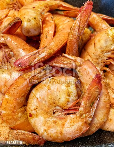Close up of a pile of steamed shrimp with Old Bay seasoning