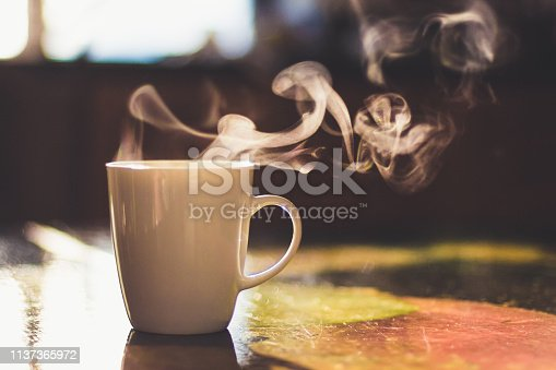 Cup of hot drink on the table