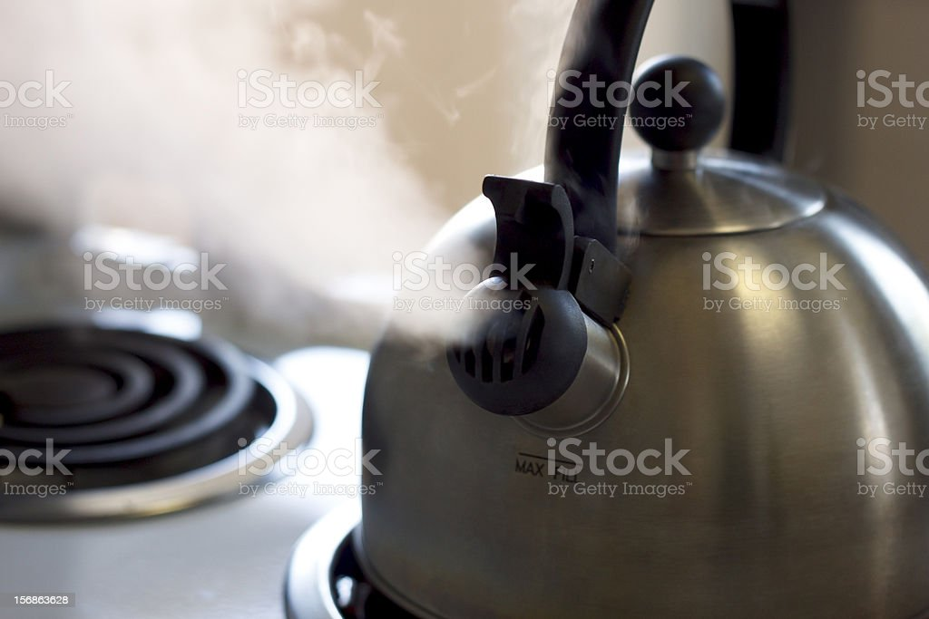 Close Up of Steaming Tea Kettle stock photo