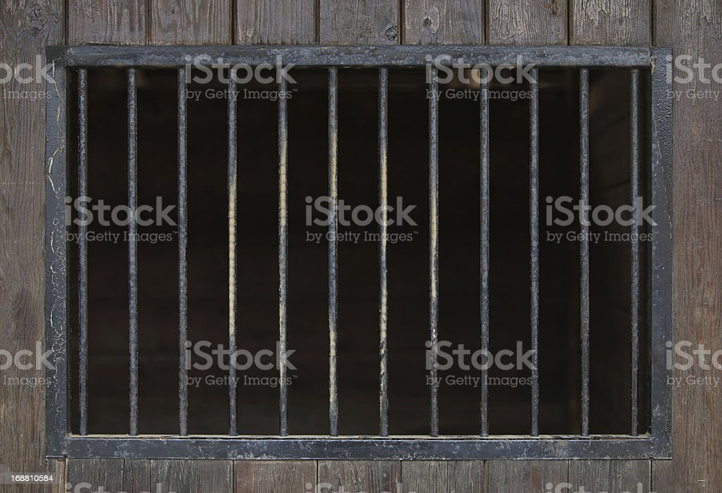 Close up of steel bars in a wooden building royalty-free stock photo