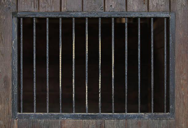 close up of steel bars in a wooden building - kooi stockfoto's en -beelden