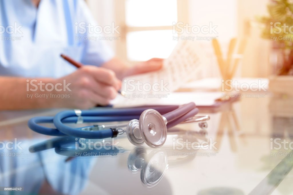 Close up of stethoscope and doctor stock photo