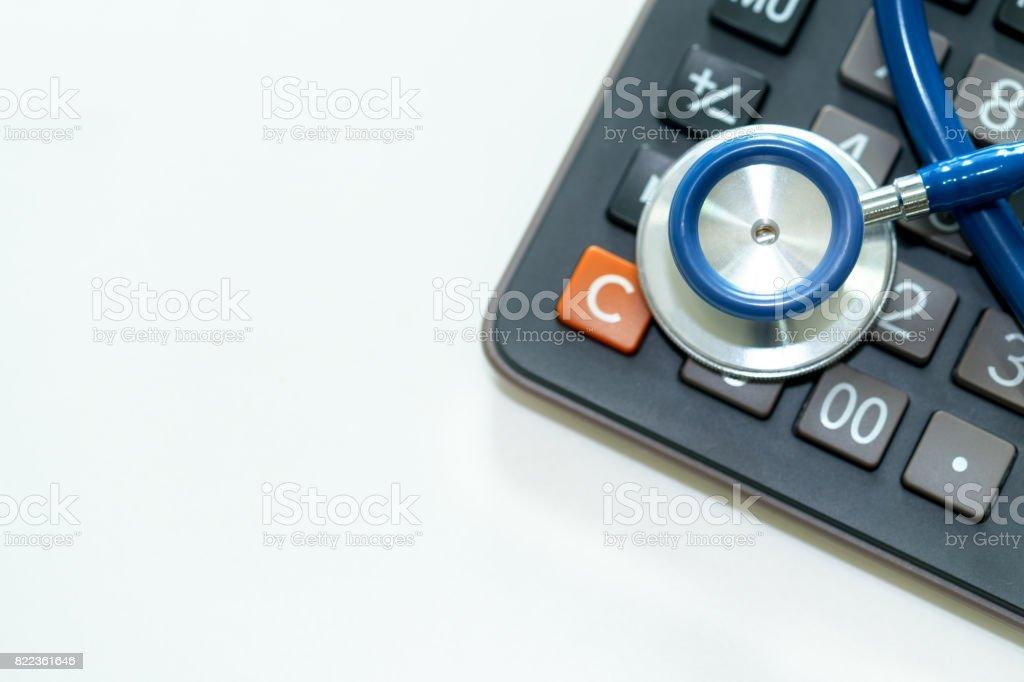 Close up of stethoscope on calculator. stock photo