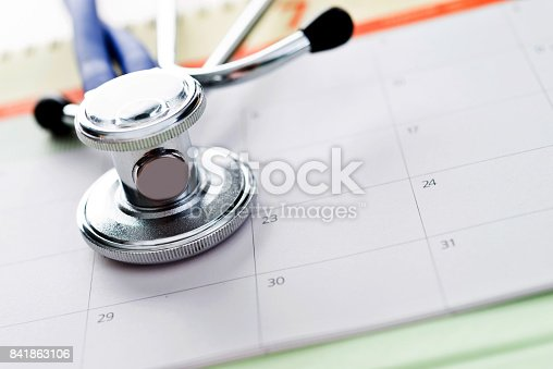 Close up of stethoscope on calendar.