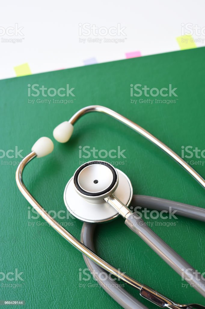 close up of stethoscope with notebook zbiór zdjęć royalty-free