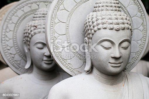 istock close up of stone Buddha statue 804332582