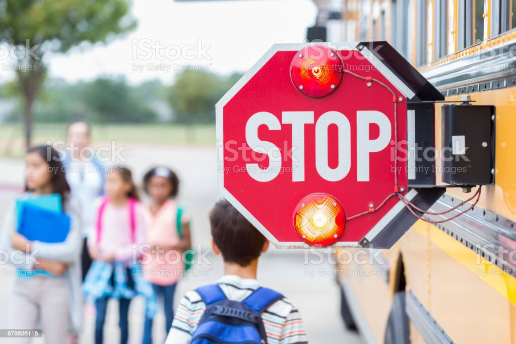 Close up of stop sign on school bus stock photo