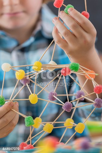 istock Close up of student's fun engineering project 648947070
