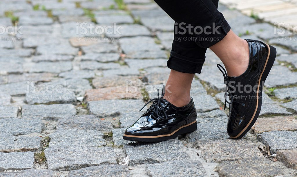 Close up of stylish female shoes.  Outdoor footwear advertising stock photo