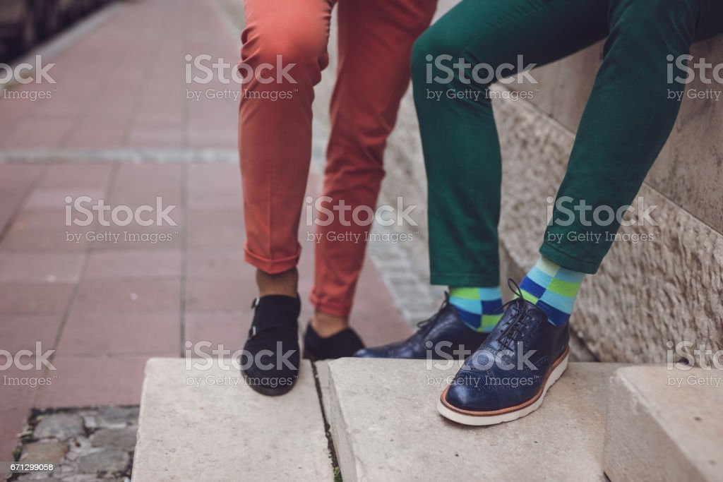 close up of stylish men legs in colorful pants and fancy shoes stock photo
