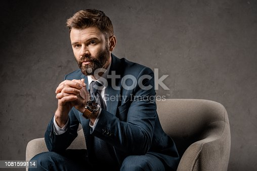 1081599130 istock photo close up of successful businessman sitting in armchair with praying hands 1081599114
