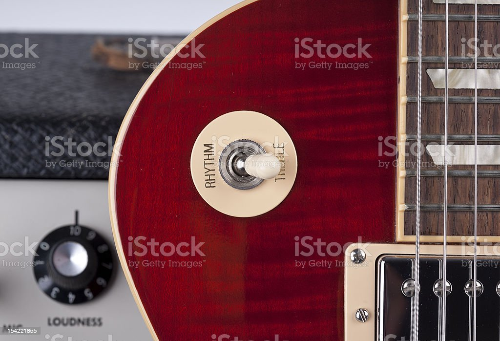 Close up of Sunburst Electric Guitar with Vintage Amplifier stock photo