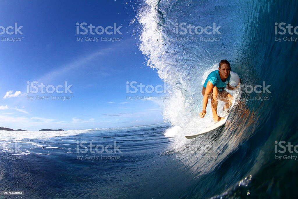 Close up of surfer in barrel stock photo