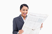 istock Close up of surprised saleswoman reading the news paper 824886920