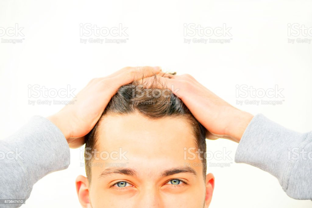 Close up of surprised young man with hands on head - Royalty-free 18-19 Years Stock Photo