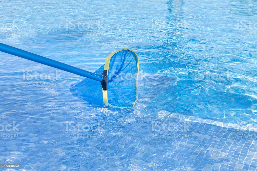 Close up of swimming pool being cleaned stock photo