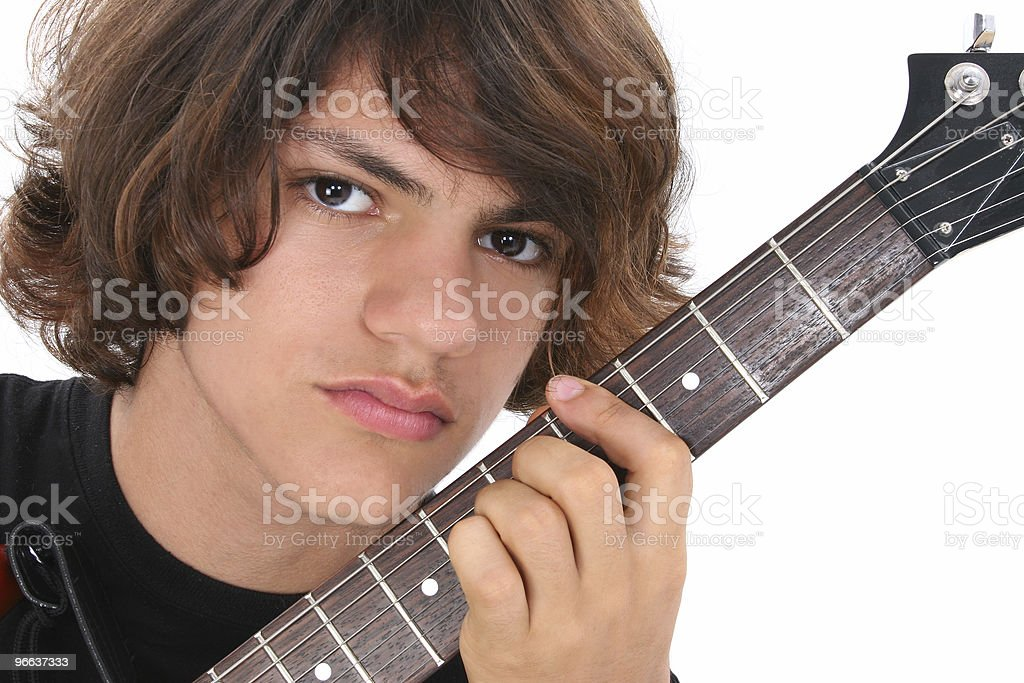 Close Up of Teen Boy With Electric Guitar Over White royalty-free stock photo