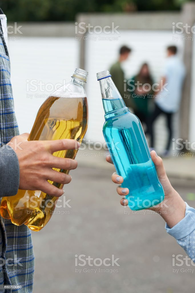 Close Up Of Teenage Group Drinking Alcohol stock photo