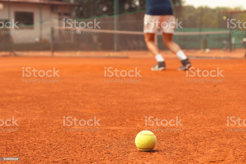 Close up of tennis ball on the court. Sport concept.