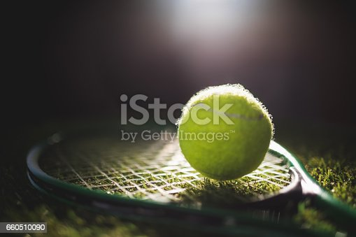 istock Close up of tennis ball with racket 660510090