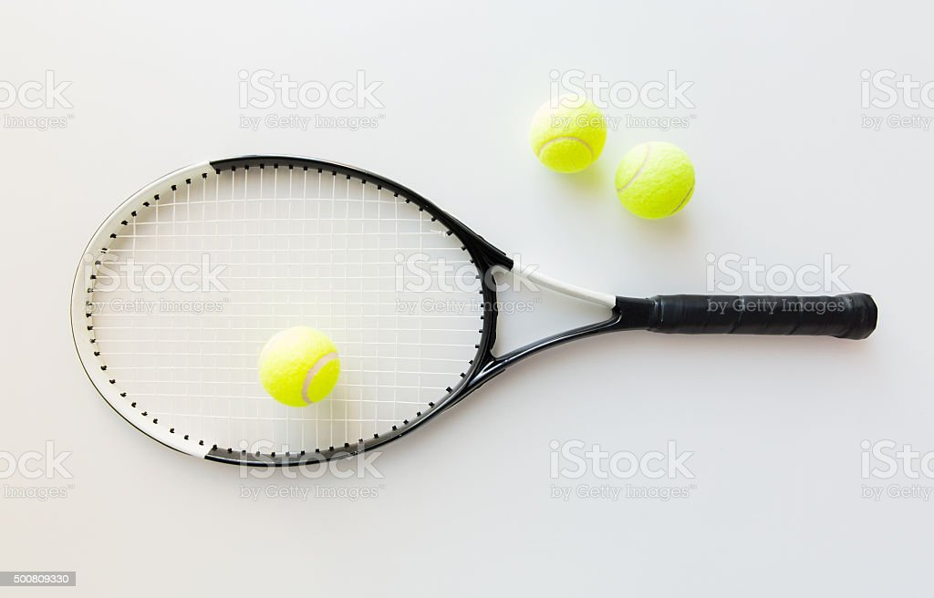 close up of tennis racket with balls royalty-free stock photo