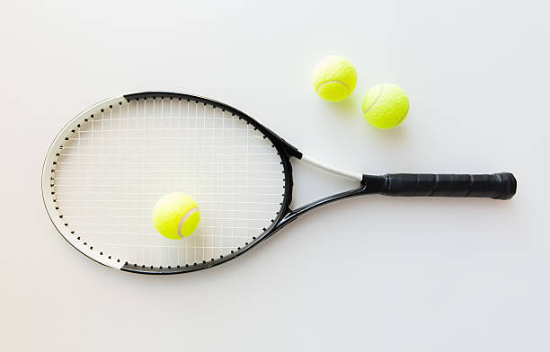 close up of tennis racket with balls stock photo