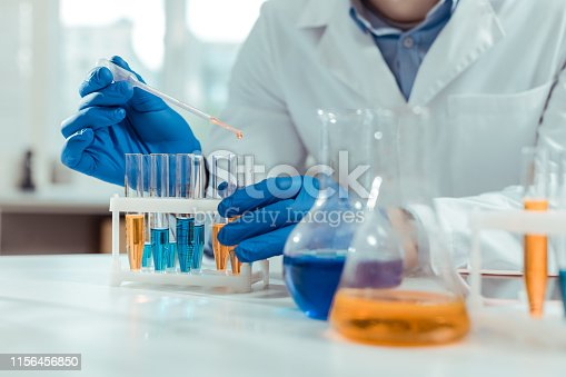 Chemical samples. Close up of test tubes being used by a smart skilled scientist in the chemical lab