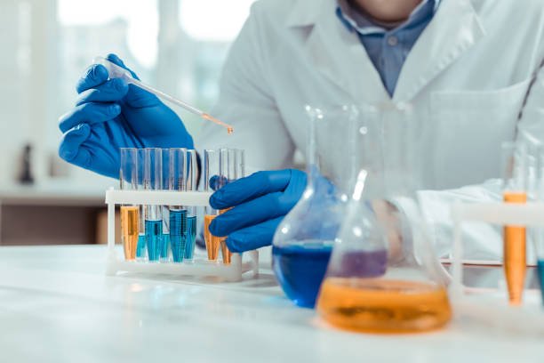 Close up of test tubes being used in chemical lab stock photo