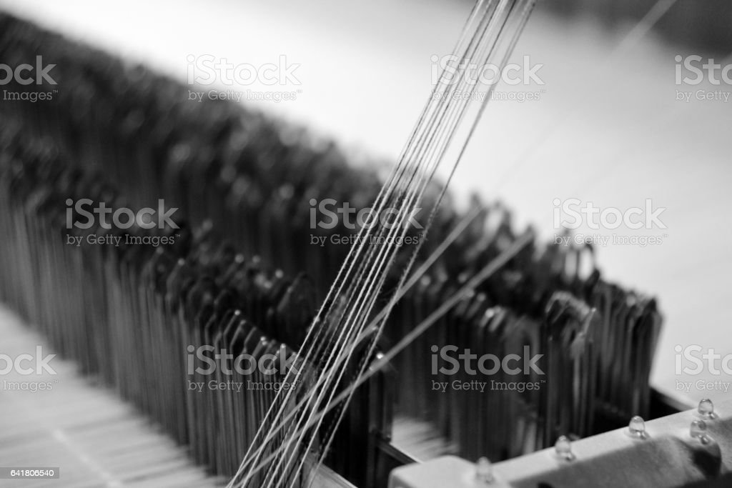 Close up of textile production needles stock photo