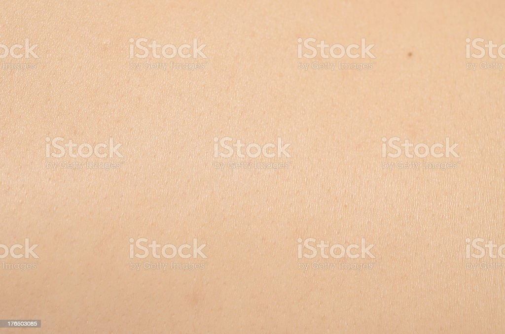 Close up of textured light colored skin with beauty spot stock photo