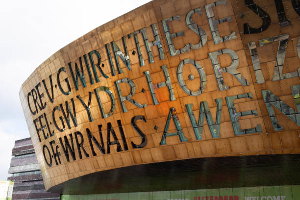 Close up of the 2 meter high lettering of The Millennium Centre. It was built to celebrate the diversity of Welsh culture. Cardiff, Wales - August 4th, 2018: Close up of the 2 meter high lettering of The Millennium Centre. It was built to celebrate the diversity of Welsh culture. It houses one large theatre and two smaller halls with shops, bars and restaurants. It's a popular area for visitors and tourist to the capital. south wales stock pictures, royalty-free photos & images