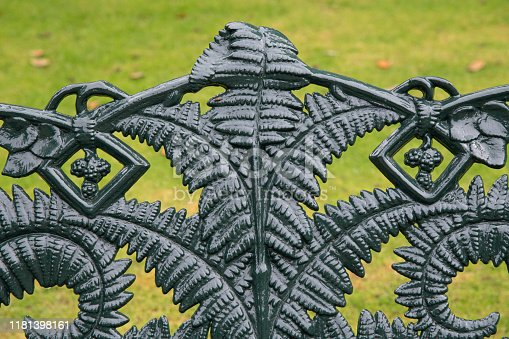 1062226450 istock photo Close up of the back of a decorative metal garden bench 1181398161