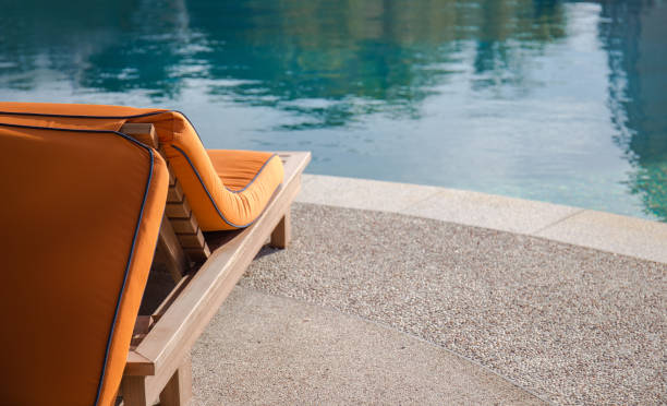 Close up of the beach lounger at swimming pool stock photo