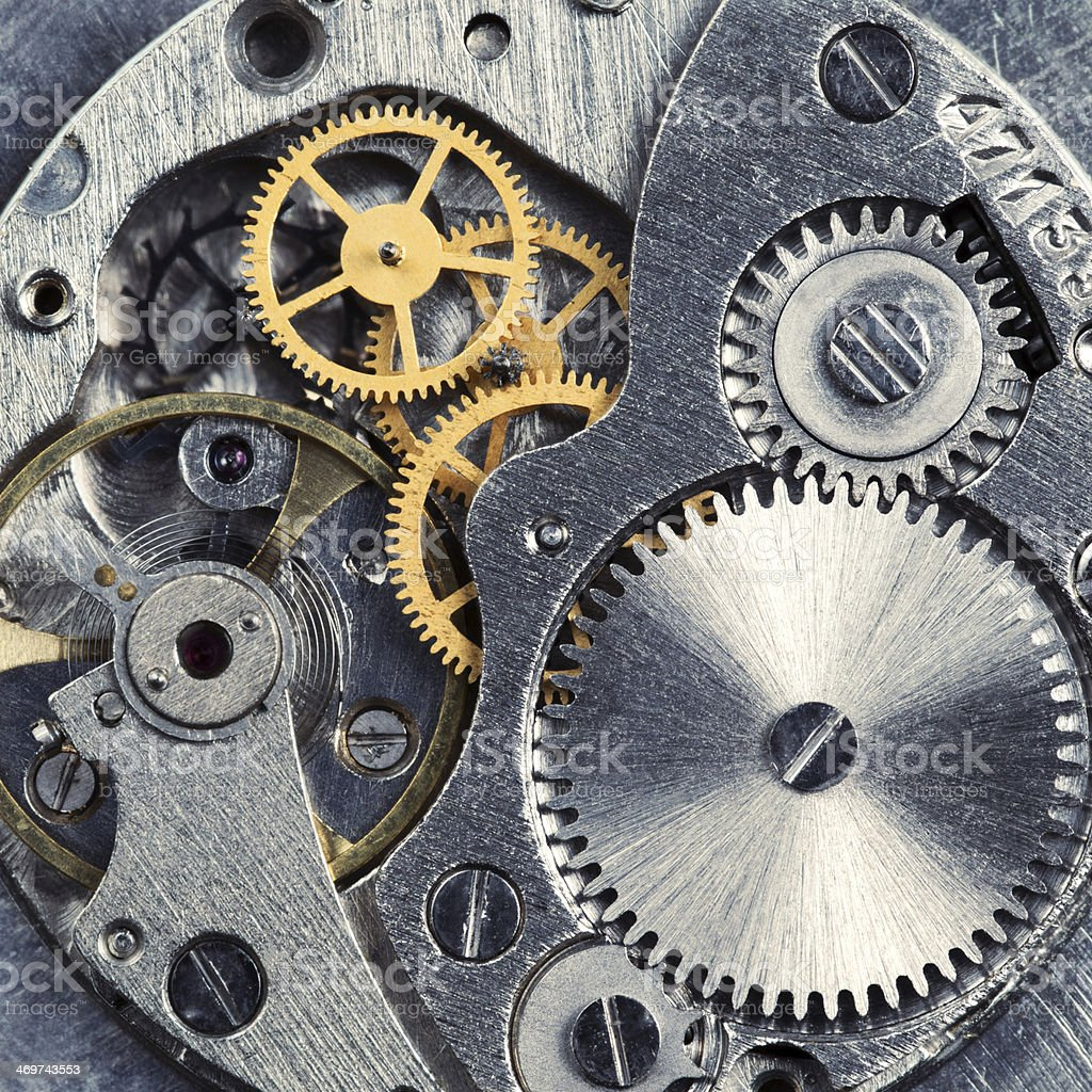 Close up of the gears of a clock stock photo